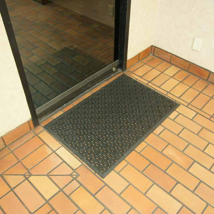 black Dura scraper drainage doormat outside of business door