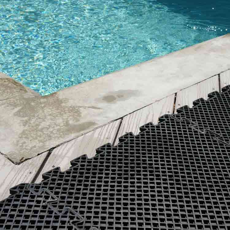 Black Eco Drain Interlocking Rubber Mat by the pool