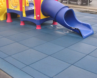 Blue Eco-Safety Rubber tiles locked together to form a playground floor