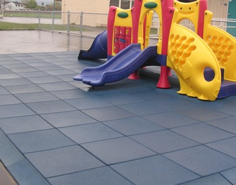 Eco-Safety Blue Playground Tile under a small jungle gym