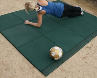 Woman doing yoga on Green Eco-sport tile outdoors