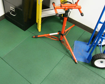 Green Eco-Sport tile floor in a garage with miscellaneous equipment