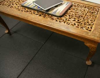 Eco-Sport Black Tile flooring under a wooden desk
