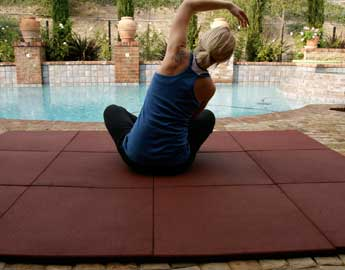 Person exercising on Red Eco-Sport tile outside near a pool
