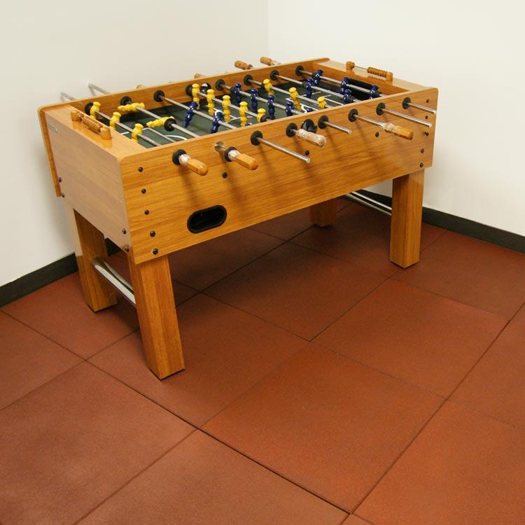 red eco sport interlocking tiles in game room under foosball table