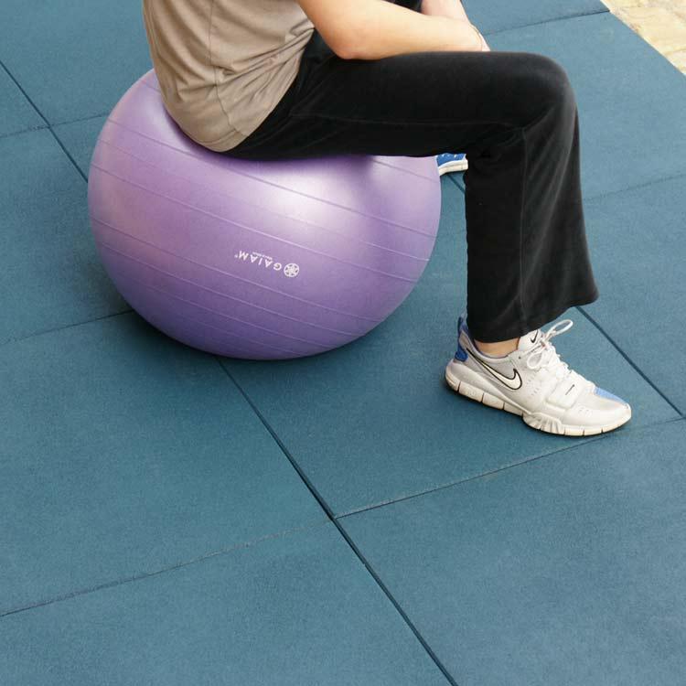 Blue Eco Sport Interlocking Rubber Flooring Tiles under person sitting on yoga ball