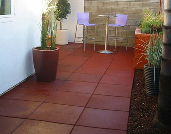 Red Eco-Sport tiles line the outside area of a house