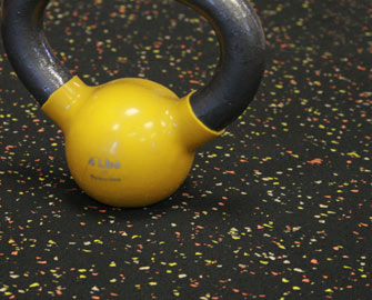 Yellow kettlebell weight on Candy Corn Elephant Bark floor
