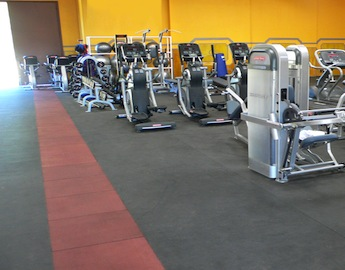 Main gym floor covered with Elephant bark Flooring and exercise machines
