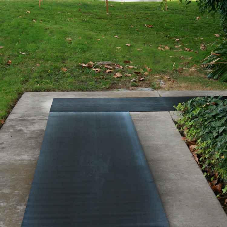Corrugated Fine Rib Rubber Mat on a cornered sidewalk
