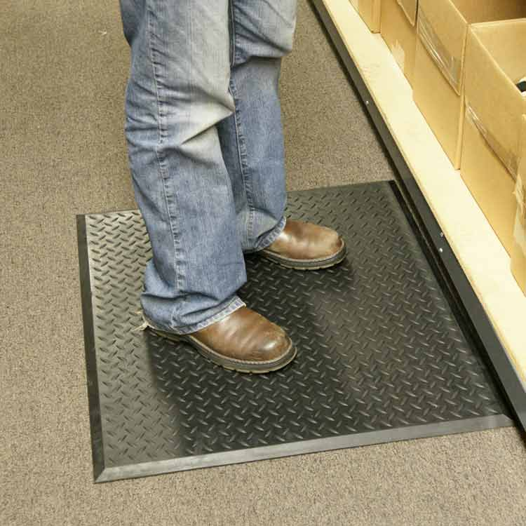 person standing on black foot rest in a room