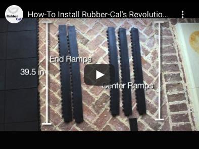 Pieces of a Revolution Rubber Tile set up on bricks