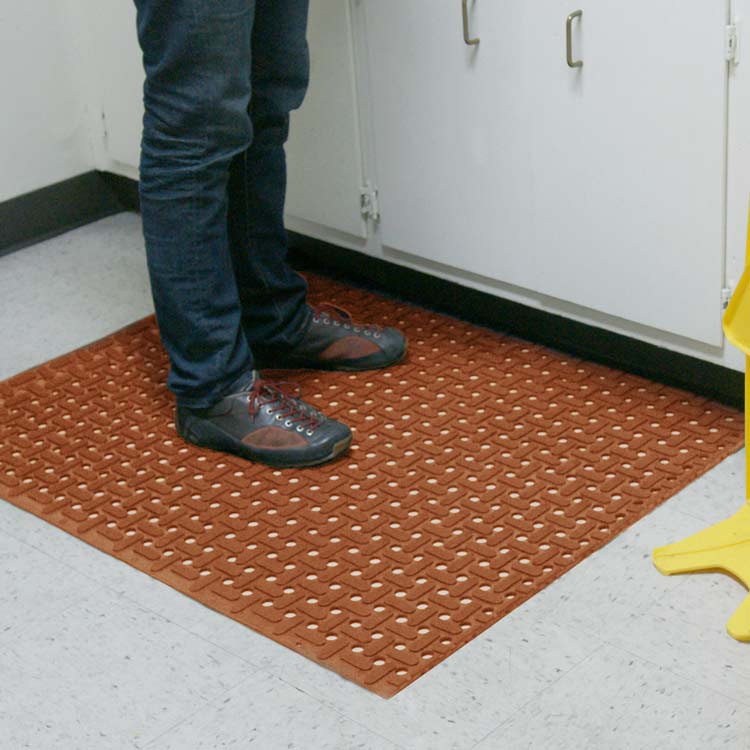 Person standing on Red Paw Grip Runner Mat by the warning sign