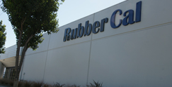 Rubber Cal Sign on white building