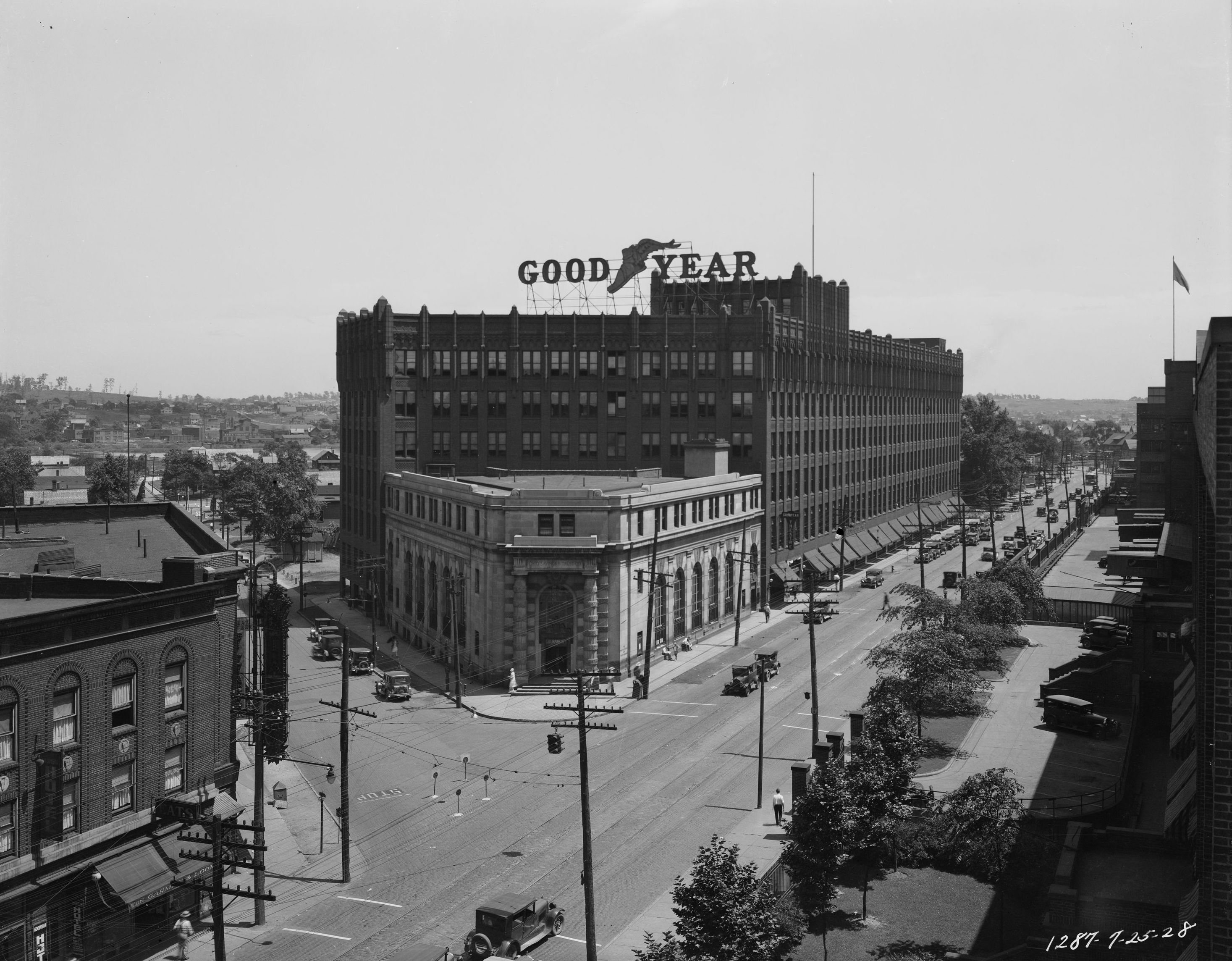 Black and White Photo of Large Goodyear Building on a street corner