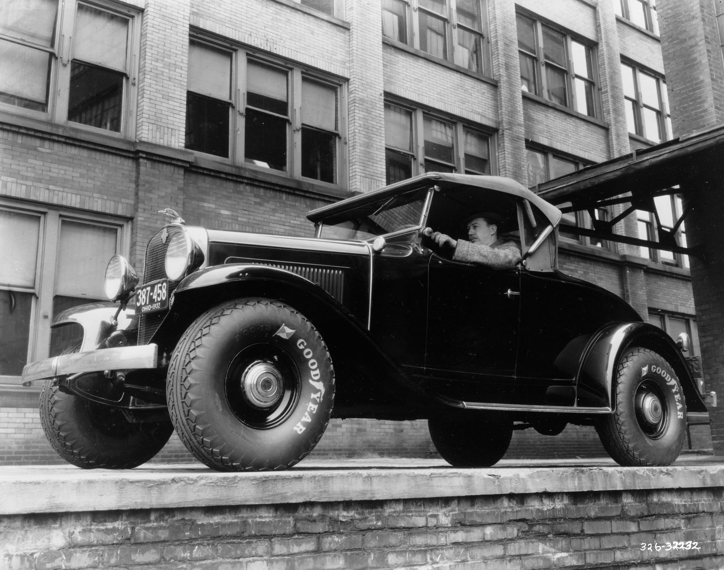 Black and White Photo of Classic Car with Goodyear Tires