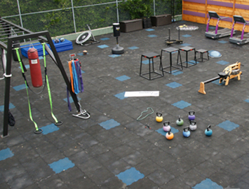 Rubber Puzzle Tiles Combined to make an outdoor gym floor