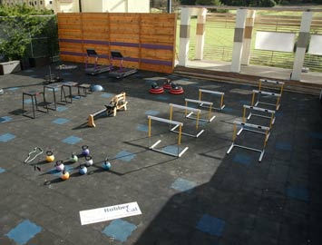 Hurdles and weight equipment on Interlocked rubber tiles