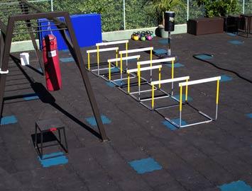 Gym equipment over Rubber-Cal Interlocking Rubber Tiles