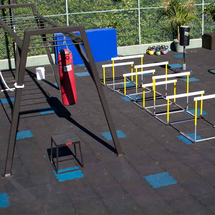 Puzzle Lock Tile floor under hurdles and heavy weight equipment