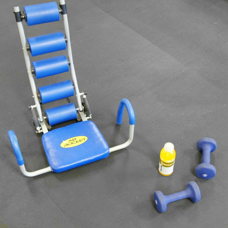 Home Workout Exercise equipment on a Recycled rubber mat