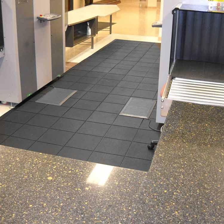 Black revolution interlocking flooring tiles in security room