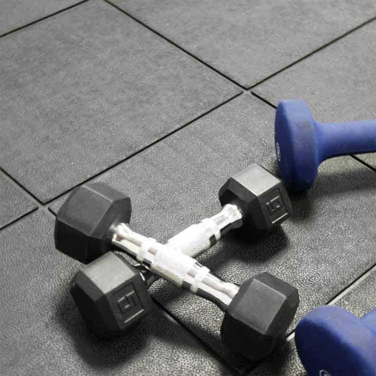 black revolution interlocking tiles on fitness equipment room