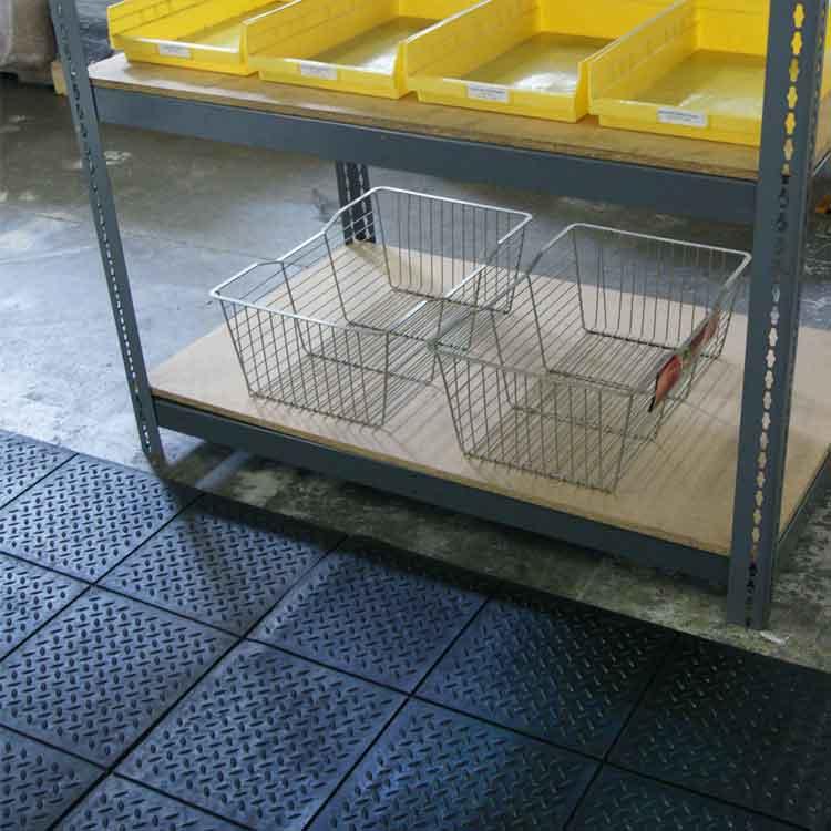 shelves on top of black revolution diamond plate interlocking floor tiles