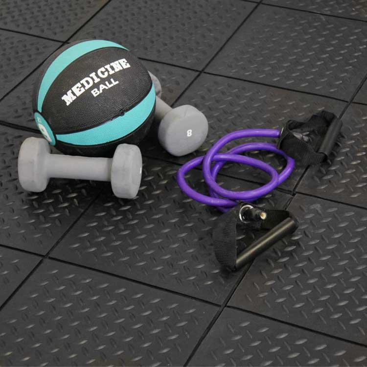 gym equipments on black revolution diamond plate interlocking floor tiles