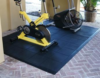Side view of two exercise bikes on Revolution interlocking tile