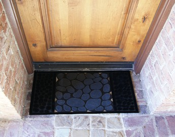 River Rocks Rubber Doormat on brick entryway to a house