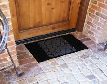 River Rocks Rubber Doormat on bricks in front of a wooden door