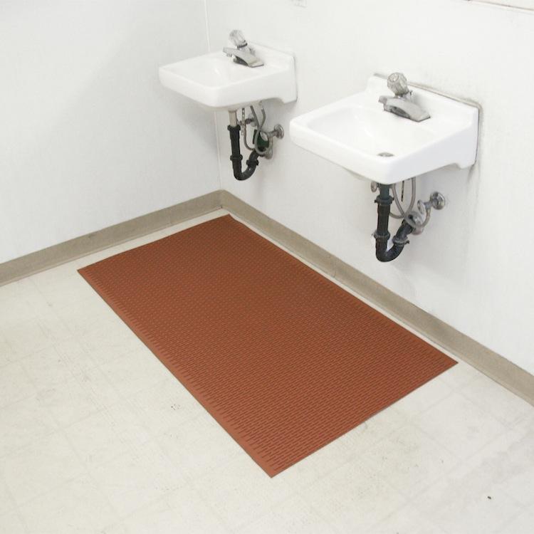 Red Safe Grip Anti Slip Rubber matting underneath sink