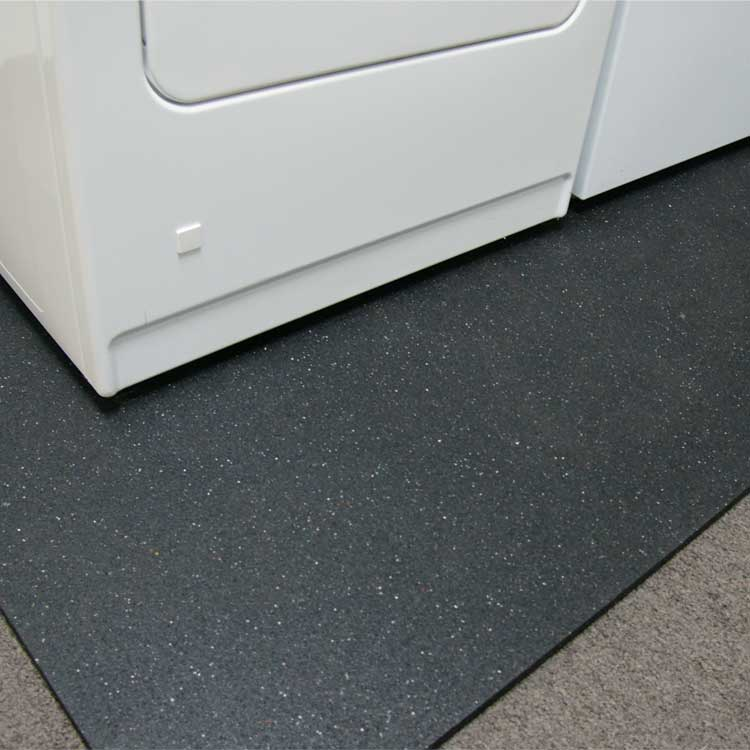 Washing machine and dryer on top of a Shark Tooth Rubber Mat