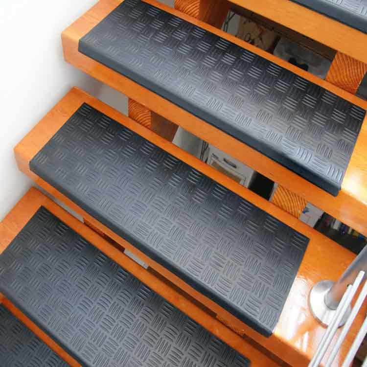 Black Diamond Grip Rubber stair tread on outside stairway
