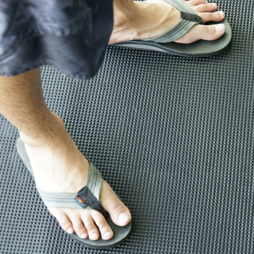 person with flip flop standing on super grip scraper rubber mat