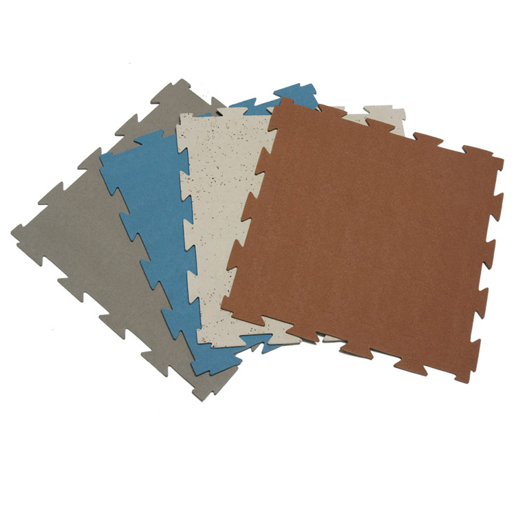 Four colored Terra Flex Rubber Tiles fanned out