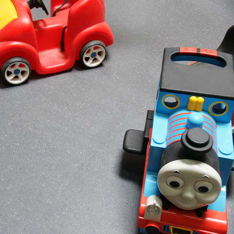 Concrete Colored Terra Flex Rubber Flooring Under Toy Train in a playroom