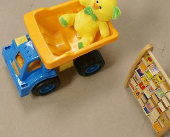 Terra Flex Tiles under children's Truck and some blocks