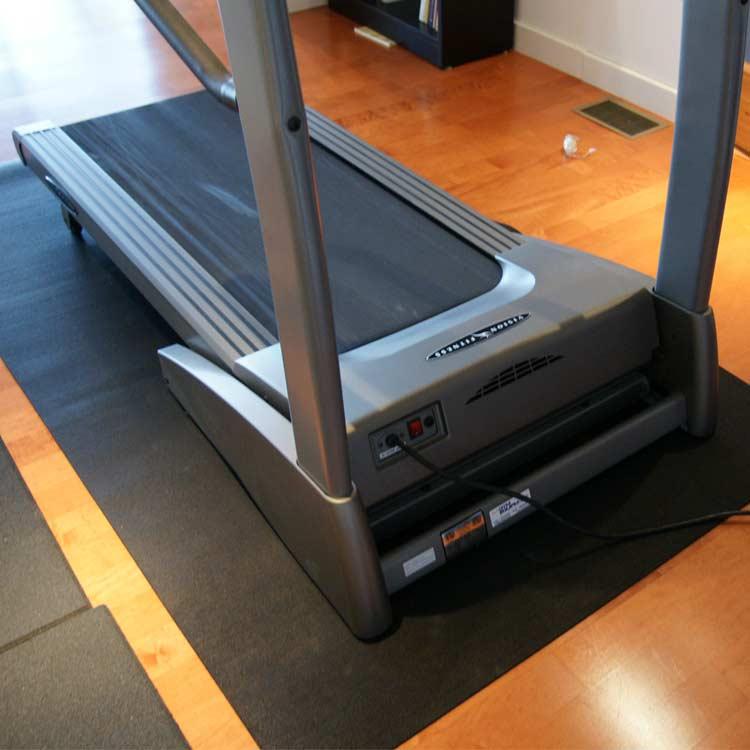 Treadmill Mat on hardwood floor and under a Treadmill