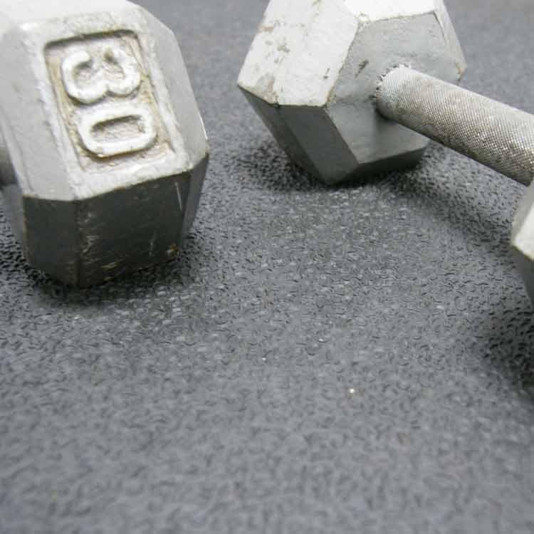 kettlebell on black tuff flex rubber mat in gym floor