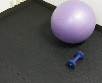 Tuff Flex Rubber Floor with exercise ball and dumbbell