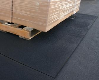 Tuff Flex supporting a loaded pallet on asphalt.