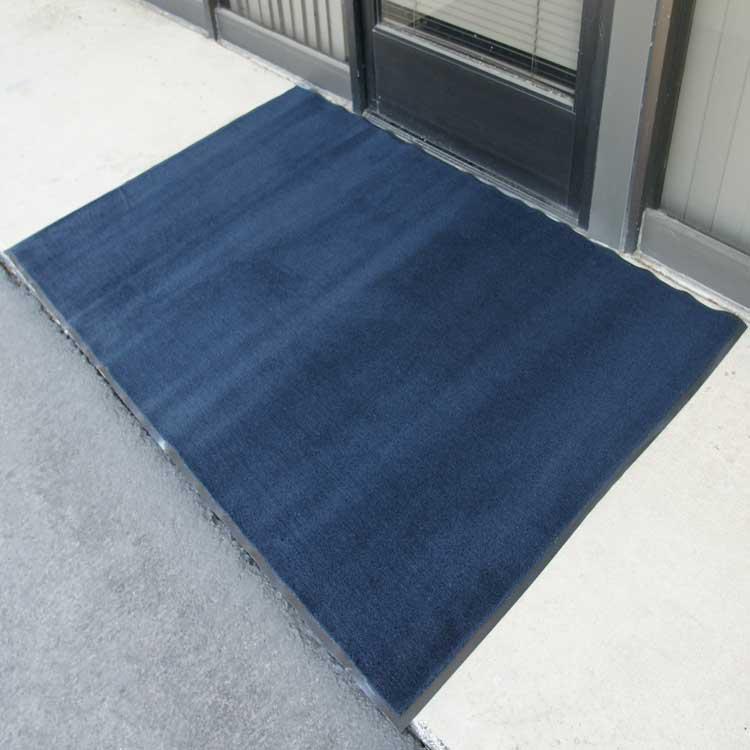 Blue Carpet Mat outside of Business Door