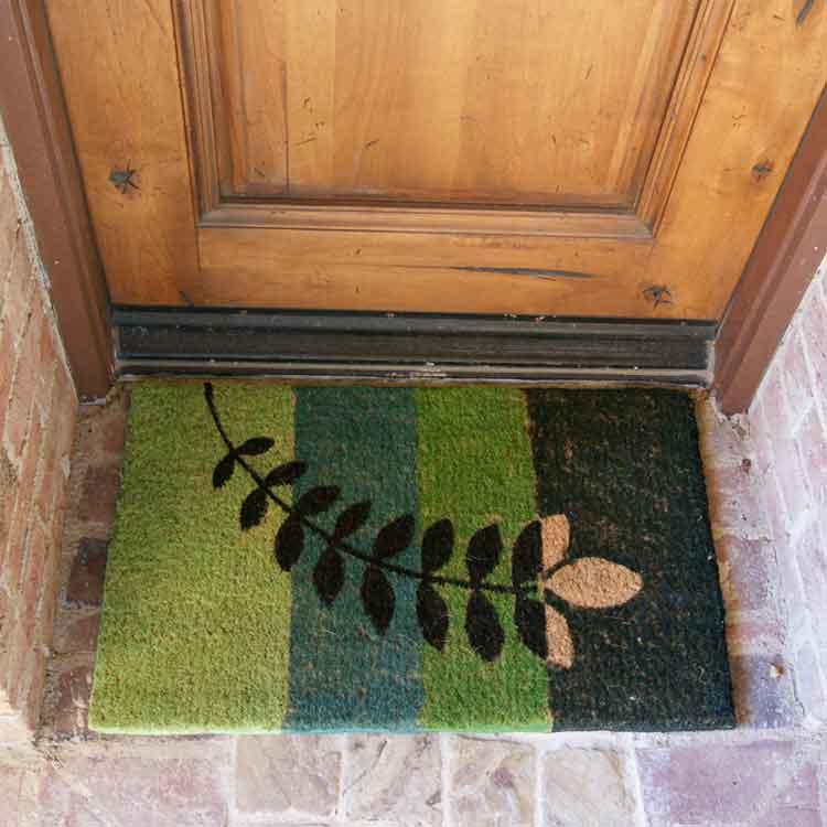 Green patterned Doormat made from coconut husk in front of door