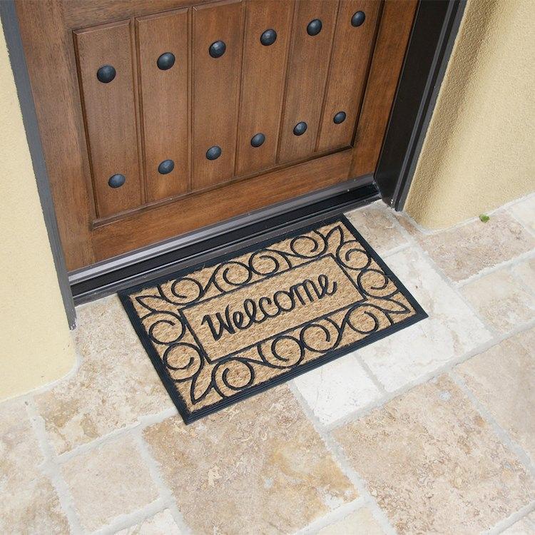Welcome Home coir Front Doormat in front of a door