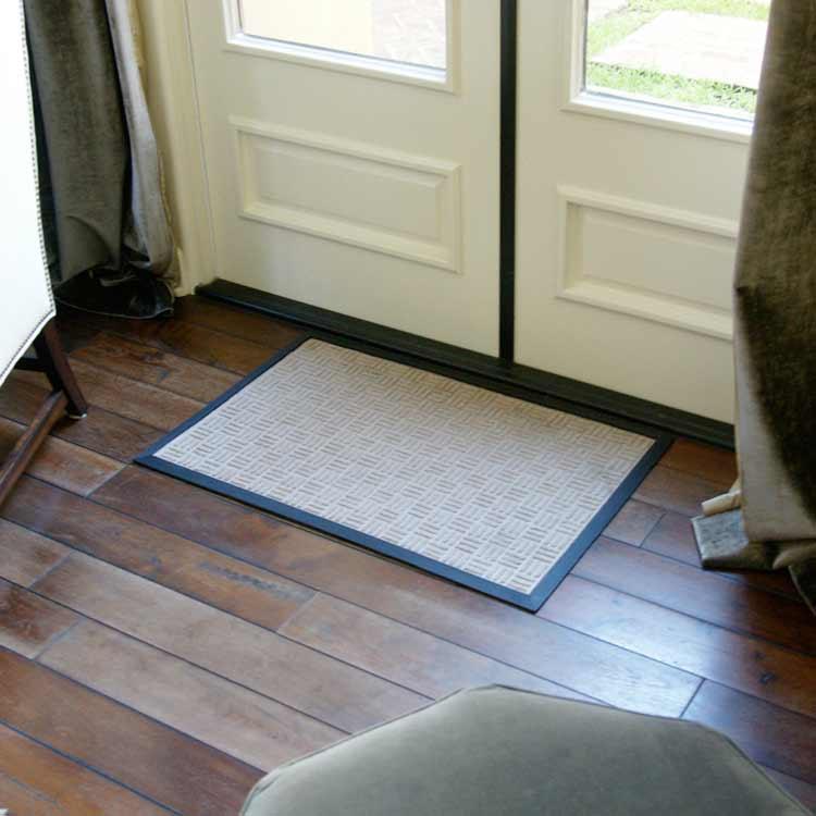 Wellington Carpet Mat on wood floor near double doors