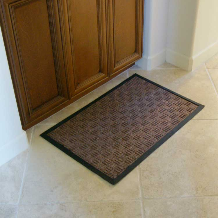 brown Wellington rubber backed carpet mats outside the door