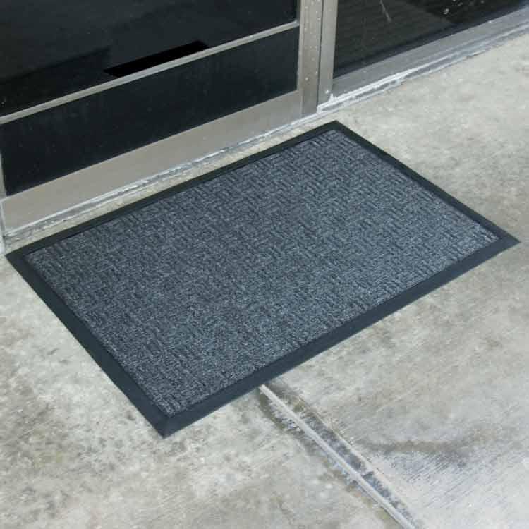 Blue Wellington carpet mat on the floor outside of glass door