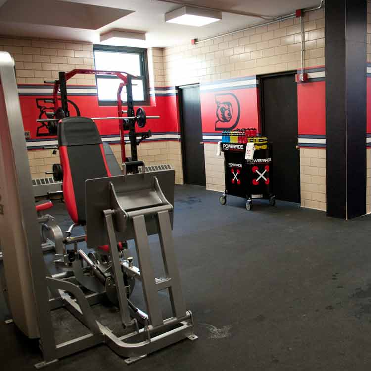 Gym with Z-Cycle flooring with exercise machines on top